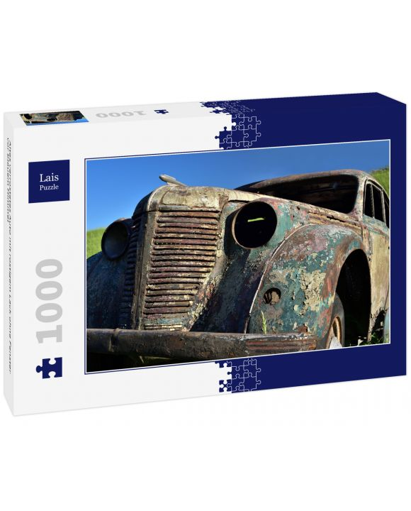 Lais Puzzle - Altes verrostetes Auto mit rostigem Lack ohne Fenster vor blauem Himmel - 1.000 Teile
