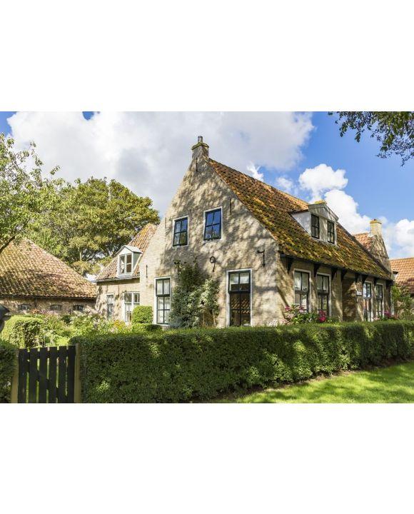 Lais Puzzle - Eines der schönen alten Häuschen (gebaut 1797) auf der Insel Ameland - 500 & 1.000 Teile
